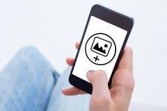 Σύνθετη εικόνα της γυναίκας που χρησιμοποιεί το κινητό τηλέφωνό της Στοκ εικόνα με δικαίωμα ελεύθερης χρήσης