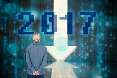 Σύνθετη εικόνα της επιχειρηματία που στέκεται με τα χέρια πίσω από την πλάτη Στοκ Εικόνες