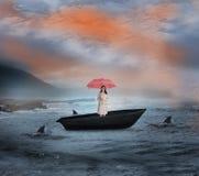 Σύνθετη εικόνα της ελκυστικής επιχειρηματία που κρατά την κόκκινη ομπρέλα sailboat Στοκ Εικόνα