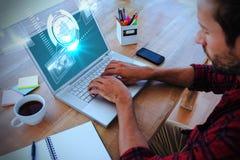 Σύνθετη εικόνα της δημιουργικής δακτυλογράφησης επιχειρηματιών στο lap-top Στοκ εικόνες με δικαίωμα ελεύθερης χρήσης