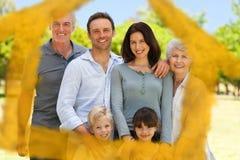 Σύνθετη εικόνα της οικογένειας που στέκεται στο πάρκο Στοκ Εικόνες