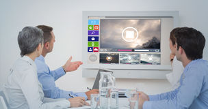 Σύνθετη εικόνα της προσεκτικής επιχειρησιακής ομάδας κατά τη διάρκεια μιας διάσκεψης Στοκ εικόνες με δικαίωμα ελεύθερης χρήσης
