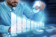 Σύνθετη εικόνα της προσποίησης επιχειρηματιών να αγγίξουν το αόρατο αντικείμενο στο γραφείο Στοκ Φωτογραφίες