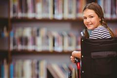 Σύνθετη εικόνα της συνεδρίασης κοριτσιών στην αναπηρική καρέκλα στο σχολείο Στοκ εικόνα με δικαίωμα ελεύθερης χρήσης