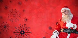 Σύνθετη εικόνα της χαλάρωσης Άγιου Βασίλη στην καρέκλα Στοκ Φωτογραφίες