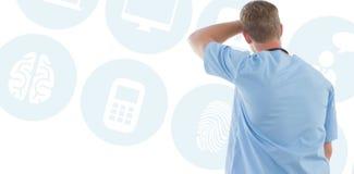 Σύνθετη εικόνα του αρσενικού κοιτάγματος γιατρών μέσω των παραθύρων Στοκ Φωτογραφία