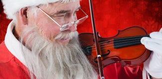 Σύνθετη εικόνα του βιολιού παιχνιδιού Άγιου Βασίλη Στοκ Εικόνες
