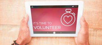 Σύνθετη εικόνα του εθελοντικού κειμένου με τα εικονίδια στην οθόνη Στοκ εικόνα με δικαίωμα ελεύθερης χρήσης