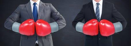 Σύνθετη εικόνα του επιχειρηματία με τα εγκιβωτίζοντας γάντια Στοκ Εικόνες