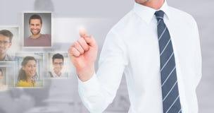 Σύνθετη εικόνα του επιχειρηματία που δείχνει με το δάχτυλό του Στοκ Εικόνες