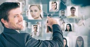 Σύνθετη εικόνα του επιχειρηματία που δείχνει με το δάχτυλό του Στοκ Φωτογραφία