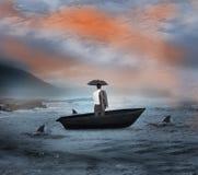 Σύνθετη εικόνα του επιχειρηματία που στέκεται sailboat Στοκ εικόνα με δικαίωμα ελεύθερης χρήσης