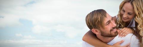 Σύνθετη εικόνα του ευτυχούς αγαπώντας ζεύγους στοκ εικόνα