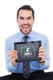 Σύνθετη εικόνα του ευτυχούς επιχειρηματία που παρουσιάζει PC ταμπλετών του Στοκ Φωτογραφίες