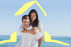 Σύνθετη εικόνα του ευτυχούς ζεύγους που χαμογελά στη κάμερα Στοκ εικόνες με δικαίωμα ελεύθερης χρήσης