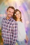 Σύνθετη εικόνα του ευτυχούς νέου ζεύγους που στέκεται πλάτη με πλάτη Στοκ Φωτογραφία