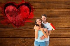 Σύνθετη εικόνα του ευτυχούς νέου ζεύγους που χρωματίζει από κοινού Στοκ εικόνα με δικαίωμα ελεύθερης χρήσης