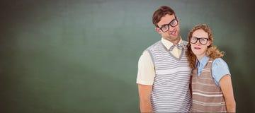 Σύνθετη εικόνα του ευτυχούς geeky ζεύγους hipster με τα ανόητα πρόσωπα Στοκ φωτογραφία με δικαίωμα ελεύθερης χρήσης