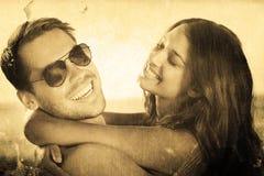 Σύνθετη εικόνα του εύθυμου αγαπώντας ζεύγους που αγκαλιάζει το ένα το άλλο Στοκ εικόνα με δικαίωμα ελεύθερης χρήσης