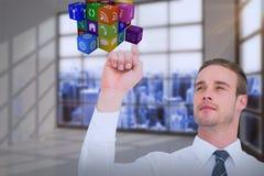 Σύνθετη εικόνα του εύθυμου επιχειρηματία που δείχνει τον κύβο με το δάχτυλό του Στοκ Εικόνες