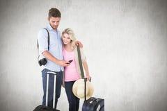 Σύνθετη εικόνα του ελκυστικού νέου ζεύγους έτοιμου να πάει στις διακοπές Στοκ Φωτογραφία