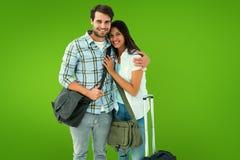 Σύνθετη εικόνα του ελκυστικού νέου ζεύγους που πηγαίνει στις διακοπές τους Στοκ Φωτογραφία