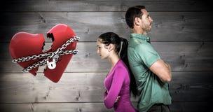 Σύνθετη εικόνα του ζεύγους που στέκεται πλάτη με πλάτη Στοκ φωτογραφίες με δικαίωμα ελεύθερης χρήσης