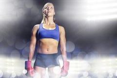 Σύνθετη εικόνα του θηλυκού αθλητή που στέκεται με τα γάντια Στοκ Εικόνες