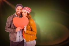Σύνθετη εικόνα του νέου εγγράφου μορφής καρδιών εκμετάλλευσης ζευγών Στοκ Εικόνες