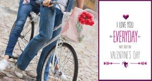 Σύνθετη εικόνα του νέου ζεύγους ισχίων που πηγαίνει για έναν γύρο ποδηλάτων Στοκ Εικόνες