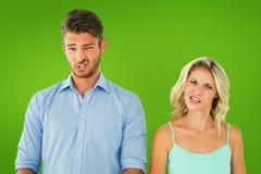Σύνθετη εικόνα του νέου ζεύγους που κάνει τα ανόητα πρόσωπα Στοκ Φωτογραφίες