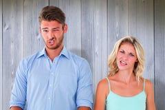 Σύνθετη εικόνα του νέου ζεύγους που κάνει τα ανόητα πρόσωπα Στοκ Φωτογραφία