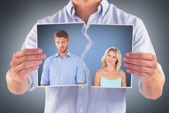 Σύνθετη εικόνα του νέου ζεύγους που κάνει τα ανόητα πρόσωπα Στοκ εικόνες με δικαίωμα ελεύθερης χρήσης