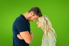 Σύνθετη εικόνα του νέου ζεύγους που στέκεται το επικεφαλής - - κεφάλι Στοκ Εικόνα