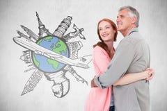Σύνθετη εικόνα του περιστασιακού ζεύγους που αγκαλιάζει και που χαμογελά Στοκ Εικόνα