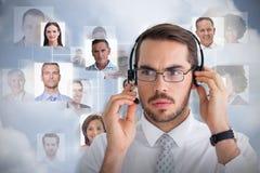 Σύνθετη εικόνα του πορτρέτου ενός επιχειρηματία με το ακουστικό Στοκ εικόνα με δικαίωμα ελεύθερης χρήσης