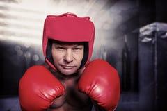 Σύνθετη εικόνα του πορτρέτου του μπόξερ με τα γάντια και το κάλυμμα Στοκ φωτογραφία με δικαίωμα ελεύθερης χρήσης