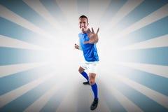 Σύνθετη εικόνα του πλήρους πορτρέτου μήκους της ευτυχούς υπεράσπισης φορέων ράγκμπι στοκ εικόνα με δικαίωμα ελεύθερης χρήσης