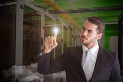 Σύνθετη εικόνα του στοχαστικού επιχειρηματία που δείχνει κάτι με το δάχτυλό του Στοκ Εικόνες