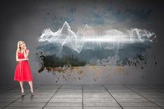 Σύνθετη εικόνα του στοχαστικού ξανθού φορώντας κόκκινου φορέματος Στοκ φωτογραφίες με δικαίωμα ελεύθερης χρήσης