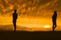 Σύνθετη εικόνα του λυπημένου ζεύγους που στέκεται πλάτη με πλάτη Στοκ Φωτογραφίες