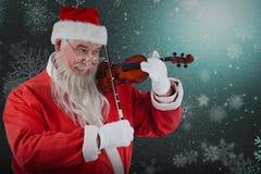 Σύνθετη εικόνα του χαμόγελου του βιολιού παιχνιδιού Άγιου Βασίλη Στοκ φωτογραφία με δικαίωμα ελεύθερης χρήσης
