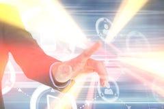 Σύνθετη εικόνα του χεριού επιχειρηματιών που δείχνει κάτι Στοκ Εικόνες