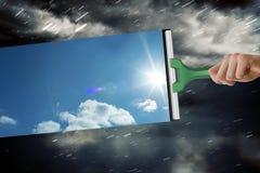 Σύνθετη εικόνα του χεριού που χρησιμοποιεί την ψήκτρα Στοκ Φωτογραφία