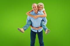 Σύνθετη εικόνα του ώριμου ατόμου που φέρνει το συνεργάτη του στην πλάτη του Στοκ εικόνα με δικαίωμα ελεύθερης χρήσης