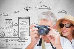Σύνθετη εικόνα το ζεύγος που παίρνει τη φωτογραφία Στοκ Εικόνα