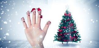 Σύνθετη εικόνα των δάχτυλων Χριστουγέννων caroler Στοκ Φωτογραφίες