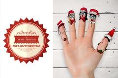 Σύνθετη εικόνα των δάχτυλων Χριστουγέννων caroler Στοκ φωτογραφία με δικαίωμα ελεύθερης χρήσης