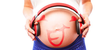 Σύνθετη εικόνα των ακουστικών εκμετάλλευσης εγκύων γυναικών πέρα από την πρόσκρουση ελεύθερη απεικόνιση δικαιώματος