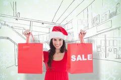 Σύνθετη εικόνα των εορταστικών τσαντών πώλησης εκμετάλλευσης brunette Στοκ εικόνες με δικαίωμα ελεύθερης χρήσης